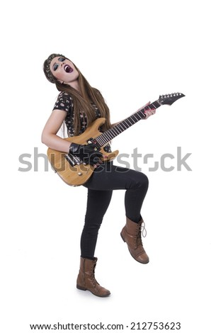Beautiful young rocker girl dressed in black singing and playing guitar isolated on white