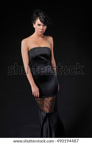 beautiful young sensual women posing in studio, model wearing black evening dress