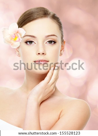Beautiful young teen with healthy clean skin of the face - isolated on white