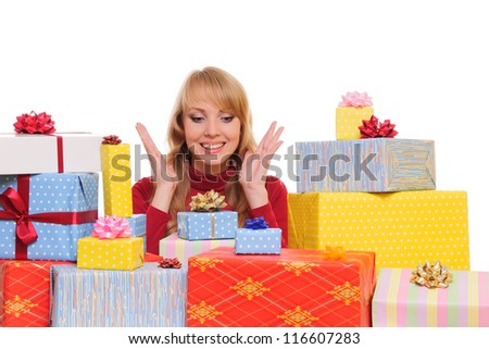 beautiful young woman and a pile of gift boxes. isolated on white background