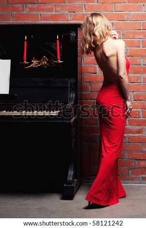 beautiful young woman and piano