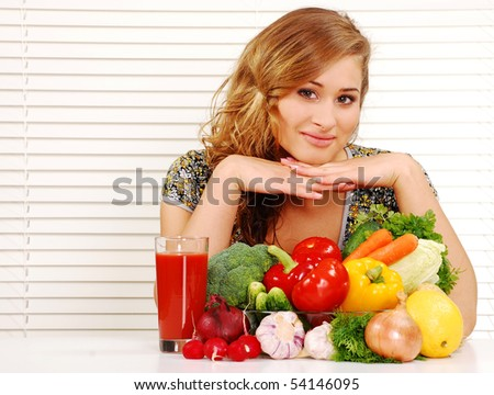 Beautiful young woman and vegetables on the table