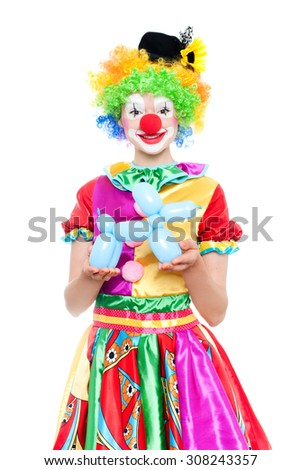 Beautiful young woman as funny clown with balloon dog- colorful portrait
