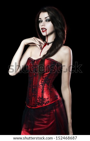 Beautiful Young woman as sexy vampire in red dress - halloween portrait