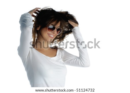 Beautiful young woman fixing her hair isolated on white