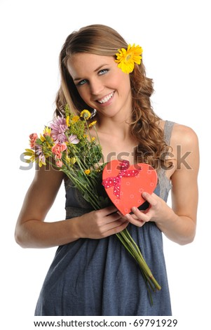 Beautiful young woman holding flowers and gift isolated over white background