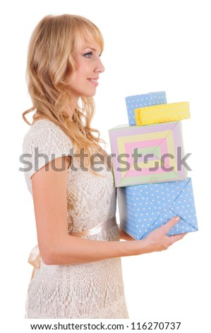 beautiful young woman holding  pile of gift boxes. isolated on white background