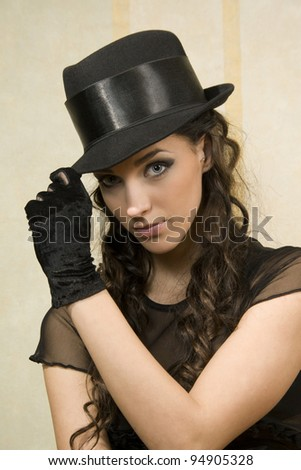 Beautiful young woman in dark  hat