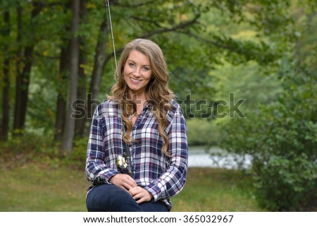 Stunning young blonde woman blue flannel stock photo for Country girl flannel shirts