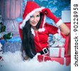 Beautiful young woman in Santa Claus clothes over Christmas background. - stock photo