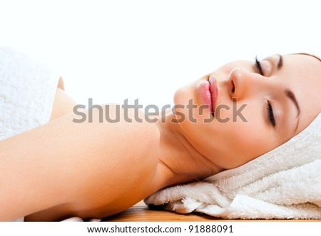 beautiful young woman lying relaxed in the spa salon