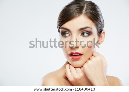 Beautiful young woman portrait  isolated on studio background. Close up face.