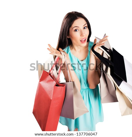 Beautiful young woman shopping, isolated on white background