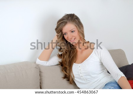 Beautiful young woman smiling and recalls
