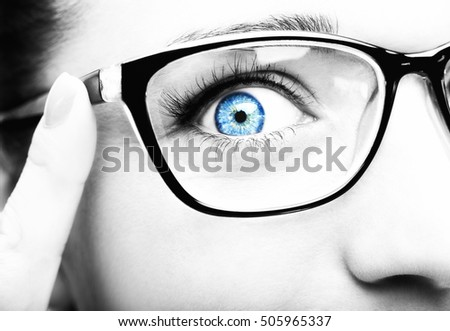 Beautiful young woman wearing glasses close-up isolated on white background.
