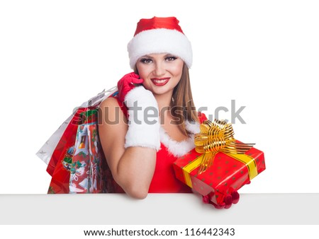 Beautiful young woman with a Christmas gift and shopping bags isolated on white background