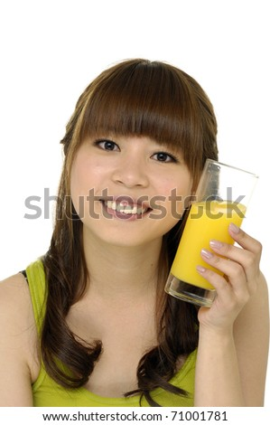 Beautiful young woman with a glass of fresh orange juice