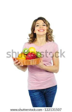 Beautiful young woman with basket of fruit  isolated on white