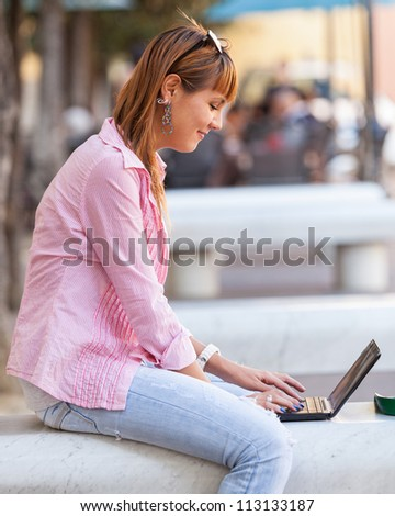 Beautiful Young Woman with Computer Outside