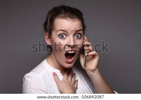 Beautiful young woman with telephone