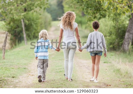 Beautiful Young Woman with Two Children Outside