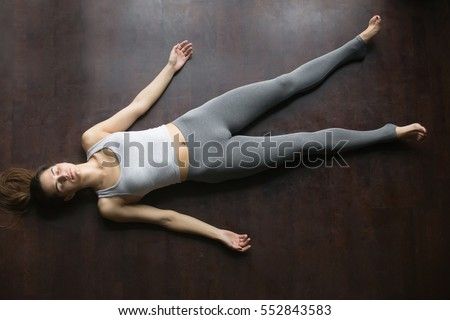 young attractive woman practicing yoga standing stock