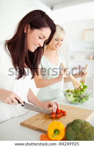 Beautiful young Women preparing dinner in a kitchen