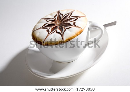 beautifully decorated cup of hot coffee with a star shape chocolate flower