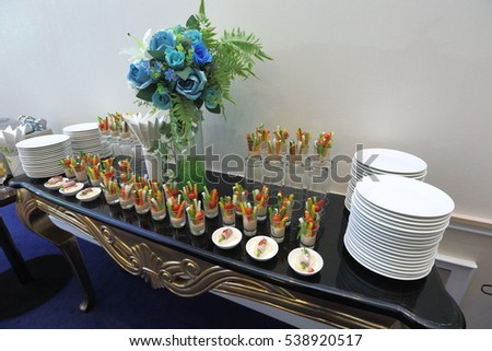 Beautifully served snacks of fruit, cheese and vegetable salad on a wedding cocktail, meeting and press conference side table