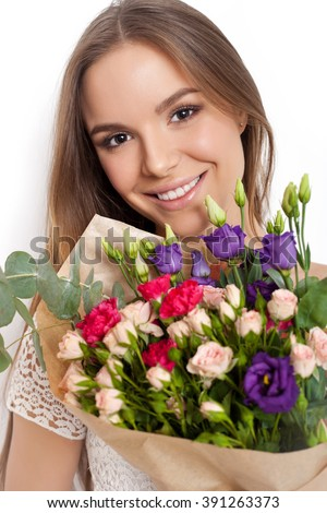 Beauty Fashion Model Woman with big Bouquet of flowers. Portrait with the Bunch . Beautiful Brunette Girl with Luxury Makeup, perfect skin. Not isolated on white background