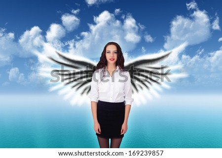 beauty girl with angel wings on sea background