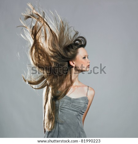 Beauty Model In Studio With Hair Blown By Wind Stock