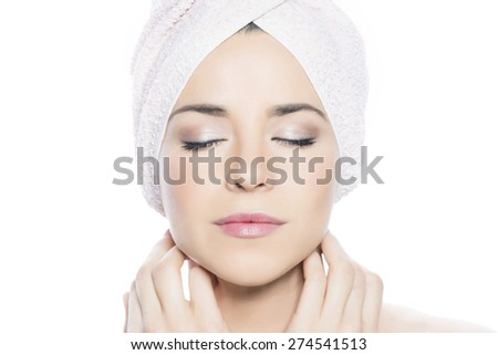 Beauty portrait of a girl with a towel around her head, eyes closed