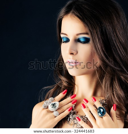 Beauty Portrait of Pretty Girl. Jewelry, Makeup and Red Nails