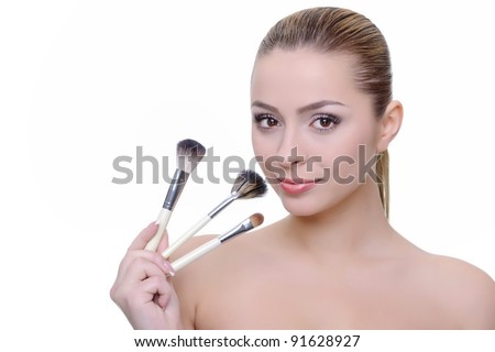 beauty portrait; woman applying make-up on white background