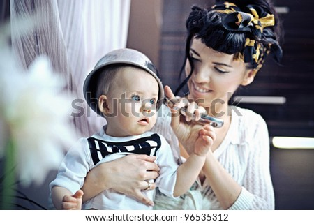 Beauty woman and baby with saucepan