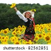 Beauty woman and sunflowers - stock photo