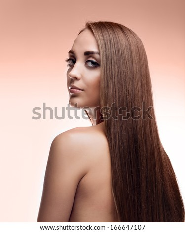 beauty woman face over brown background.