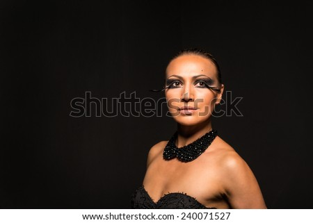 Beauty woman on the black background