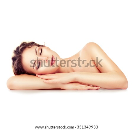 Beauty Woman Relaxing and Lying Down. Spa Girl. Sleeping or Resting Female isolated on White Background. Relax. Relaxation. Beauty Salon. Space For Your Text