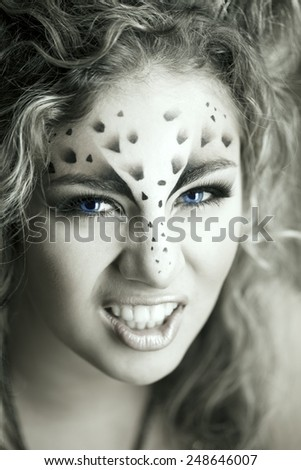 Beauty woman with makeup in snow leopard style. Fashion makeup model face. Luxury girl with trendy make up