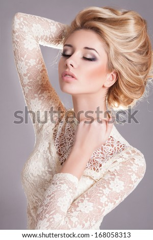 Beauty woman with wedding hairstyle and makeup. Bride fashion. Jewelry and Beauty. Woman in white dress,perfect skin, blond hair. Girl with stylish haircut. Skincare.