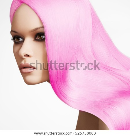 Beautyful woman with chic long wave hair on white backgrpund. Beauty girl with healthy long shiny hair. Sexy young  woman with smooth hair in pink color. Hairstyle and haircare. Bright coloring