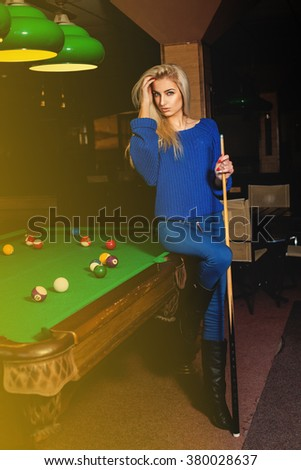 Beddable young beauty woman posing at pool table. Billiard sport concept. American pool billiard. Pool billiard game.