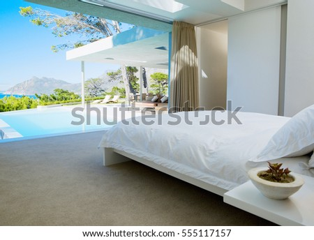 Bedroom interior. Luxury interior designed bedroom with comfy pillows. Interior of a hotel bedroom in the morning