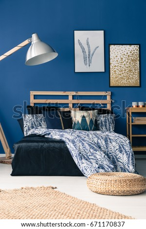Nice Bedroom With Cyan Wall And Wooden Furniture
