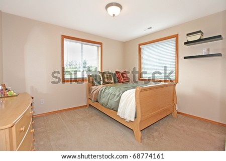Bedroom with light and simple furniture.