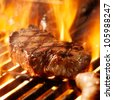 beef steak on the grill with flames. - stock