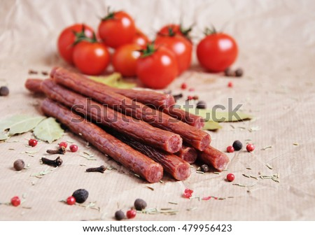 Beef sticks, sausages on a paper background, snack for Octoberfest