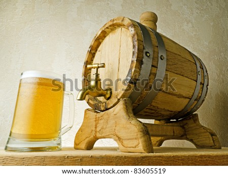 Beer and barrel on the wood table.